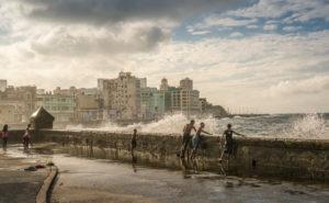At the Malecon Havana, playing children, splashing surf, drops of water, Cuba
