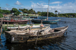 Fishing boats at the jetty, rowing boats with sail, Cuba