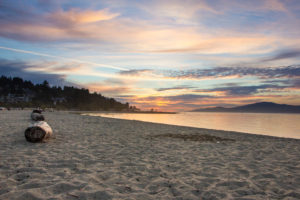 Vancouver beach with trunks, Spanish Banks, evening mood, Canada