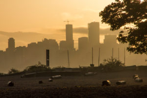 Vancouver skyline with beach with trunks, evening mood, Canada