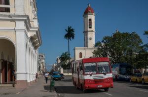 Bus in Cienfuegos with cathedral de Nuestra Señora de la Purísima Concepción in the background, Cuba