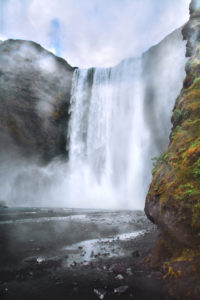 Skógafoss, Dramatic, 60m waterfall on a rocky cliff, Iceland