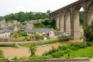 View of the river Rance, viaduct and old town houses of Dinan, Departement Cotes d'Armor, Brittany, France