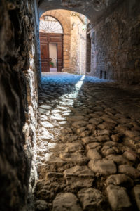 Alley in Spello, province of Perugia, Umbria, Italy