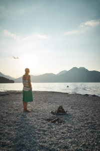 Woman at sundown in the back light in summer in the Walchensee, Bavaria