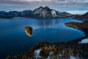 Drone recording of Walchensee in Bavaria, Germany, the first snow on the trees, November in the Walchensee