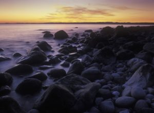 Norway, Telemark, the North Sea, Skagerag, Mölen, beach with glacial pebbles after sunset,