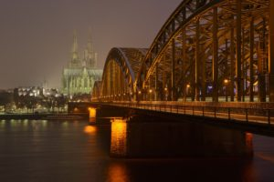 Germany, North Rhine-Westphalia, Cologne, view from the Rhine from the Deutz Rhine banks, philharmonic concert hall, Cologne Cathedral and Hohenzollernbrücke at night,