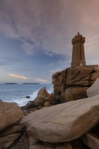 France, Brittany, Côtes-d'Armor, Côte de Granite Rose, Ploumanac'h, granite rock and lighthouse at Pointe de Squewel, also point de Squéouel, daybreak