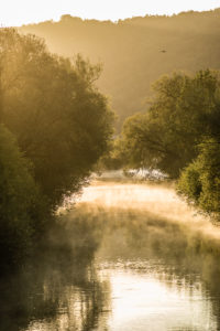backlight setting in an early morning on the river Altmuehl near Böhming, Bavaria, Germany