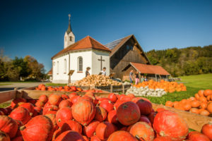 Pumpkins for sale in front of a chapel, Isny, Baden-Wuerttemberg, Germany