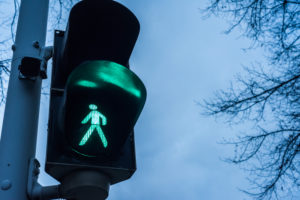 A pedestrian crossing light in the evening hours at the Friedrich square, Mannheim, Baden Wurttemberg, Germany