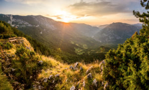 A break bench stands in the evening sun over the mountain range over the canyon of the river Tara, Zabljak, Durmitor National Park, Montenegro.