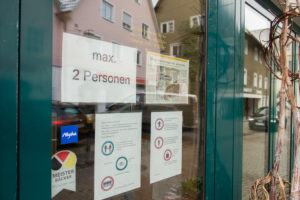 Due to the corona pandemic, restrictions on passenger traffic in the city center of Leutkirch are displayed on a shop door, Baden-Württemberg, Germany