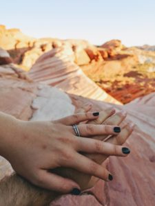Hands with engagement ring, marriage proposal in Valley of Fire State Parks, USA, Nevada
