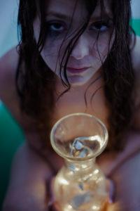Woman in bathtub with lights, bad mood, crying, sad feeling,