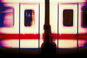 Abstractly blurred bodywork of a passenger train with two windows and doors,