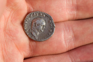 Roman silver coin with portrait of caesar