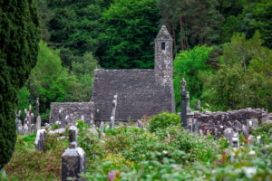 Old stone church in the monastery of Glendalough in Ireland