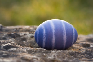 natural-colored Easter egg in the garden