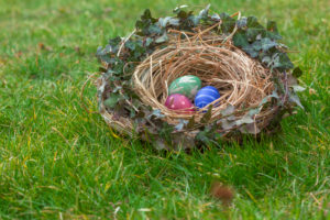 Nest of natural-colored Easter eggs in the garden