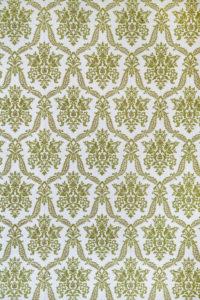 alte Tapete mit barockem und antikem Muster in grün weiß als Hintergrund