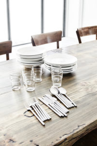 Plate, glasses and cutlery on old wooden table