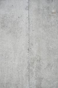 Beton grau Wand mit Struktur und Einschlüssen als Hintergrund