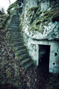 Remains of stairs and a bunker on a mountain in a wood in winter in Alsace