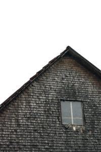 gable, facade, windows, old shingles, grey and weathered on a wooden house in the Black Forest