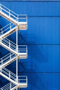 white fire escape on a blue facade