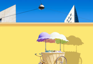 An ice cream van stands in front of a yellow wall, composing