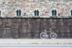 white bicycle painted on a wall