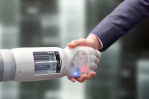 Robot shakes hands with a man