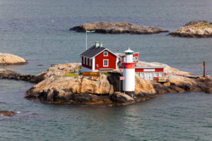 Sweden, small archipelago island with house and lighthouse between Fedjefjord and Fensfjord