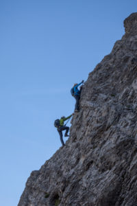 Climber on the via ferrata to Lachenspitze, Tannheimertal, Tyrol, Austria