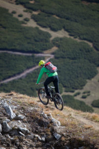 Mountain biker on the way to Peilspitze, Gschnitztal, Stubaier Alps, Tyrol, Austria