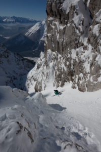 Ski touring downhill in Dammkar, near Mittenwald, Karwendel, Bavaria, Germany