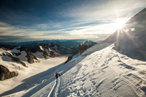 Series on barre des ecrins, group of mountaineers at sunrise, accending the glacier barre du ecrins, at sunrise, dawn, glacier blanc, des ecrins, alps, france