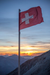 Swiss flag in front of afterglow, mood, flag, mountain landscape, mountain, clouds, trekking, Switzerland, Tracuit, Zinal, series Tracuit, sport, rock, snow, hut, summit