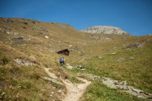 Wanderer in front of mountain landscape, way, hut, footpath, trekking, path, mountain, summit, sport, nature, alpine tour, glacier, Zinal, Tracuit, way, Switzerland, alps, series Tracuit