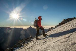 1 person, trekking, scenery, summit, glacier, energy, 1 person, alone, seated, mountain, scenery, glacier, sea of fog, joy, looking into camera, energy, balanced, destination, success