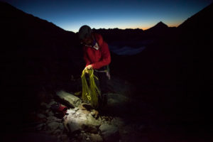 Mountaineer during preparation for roping up, rope, sunrise, 4000 m, adventure, glacier, trekking, Switzerland, outdoors, series Britanniahütte, sport, cold, night, dusk