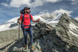 1 person stands in front of mountain range, joy, upraising, mountain, clouds, moody, summit, destination, trekking, Switzerland, Tracuit, Zinal, series Tracuit, sport, mountain range, snow, hut,