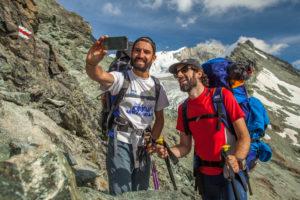 Pose for Selfie, trekking, Switzerland, Tracuit, Zinal, series Tracuit, 1 person, sport, destination, summit, mountain range, snow, hut, sign, alpine path,