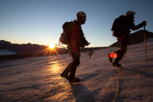 Mountaineer in front of sunrise, silhouettes, mountain landscape, horizontally, ice, glacier, the sun, loneliness, silence, glacier, destination, success, sunrise,