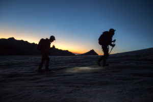 Mountaineer with climbing iron, silhouettes at sunrise, mountain landscape, 4000 m, adventure, trekking, Switzerland, outdoors, Zinal, series Britanniahütte, sport, cold, sunrise,