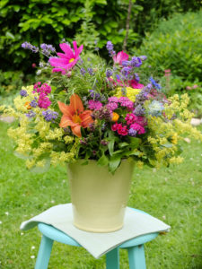 Colorful bouquet with lilies, lady's mantle, cosmea and lavender