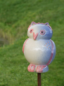 Ceramic garden decoration, owl as a garden plug