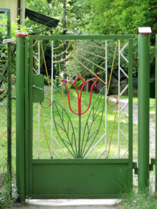 Garden gate made of metal with the tulip motif